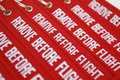 Remove before flight ribbons on white background Stock Images
