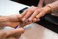 Removing the cuticle by manicure nippers Royalty Free Stock Photo