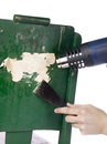 Removing paint using blowtorch and chisel Stock Photo