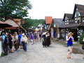Renaissance faire new york festival village with patrons Stock Photo