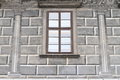 Renaissance window grey in the wall with paintings of bricks and columns Royalty Free Stock Photo