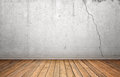 Rendering of interior with white concrete cracked wall and wooden floor. Royalty Free Stock Photo
