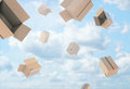 Rendering of open empty light beige cardboard mail boxes falling from the blue cloudy sky.