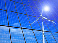 Renewable energy array of solar panels with wind turbine reflection Stock Photography