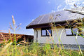 Renewable energy house with photovoltaic roof solar and thermal panels on Royalty Free Stock Photography