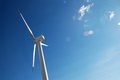 Renewable energy wind generator on blue sky Royalty Free Stock Photo