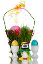 Renewable Grass Easter Basket With Easter Eggs Stock Images
