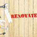 Renovate against tools on wooden background the word Royalty Free Stock Photos