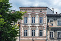 Renovated ancient tenement next to dilapidated building in the old town market square in bielsko biala poland Royalty Free Stock Photography