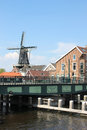 Renovated bridge and windmill de adriaan haarlem mill was built in on the foundations of a medieval defence tower for grinding Stock Photo