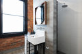 Renovated warehouse bathroom with vintage basin Royalty Free Stock Photo