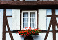 Renovated windows in village house with shutters timber frame Royalty Free Stock Images