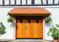 Renovated wooden garage doors in old house alsace france Royalty Free Stock Images