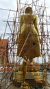 Renovation of big golden standing buddha sculpture statue Stock Photography