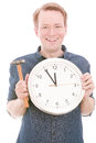 Renovation time young smiling man holding a clock and a hammer for your construction and concepts isolated on white focus is on Royalty Free Stock Photo