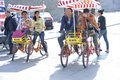 Rent bicycle visitors to play on a four wheel bike married couples with their children Royalty Free Stock Photography