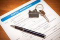 Rental agreement form close up of lease empty document with pen Royalty Free Stock Photo