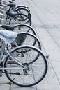 Rental bikes bicycle promoting clean transport Royalty Free Stock Photos