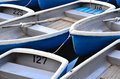 Rental boat fleet tied together Stock Photography