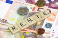 Rente german word on banknotes and change Stock Photos