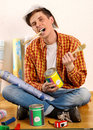 Repair home man holding paint roller for wallpaper. Royalty Free Stock Photo