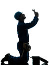 Repair man worker despair praying silhouette Stock Images