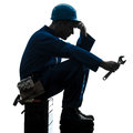 Repair man worker sad fatigue failure silhouette one repairman in studio on white background Stock Photos