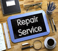 Repair Service - Text on Small Chalkboard. 3D. Royalty Free Stock Photo
