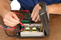 Repair technician or engineer repairing a voltage inverter Royalty Free Stock Image