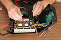 Repair technician or engineer repairing a voltage inverter Stock Photos