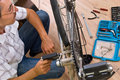 Repairing bike Stock Photography