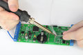 Repairing electronic board with reek soldering and printed circuit Stock Images