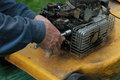 Repairing lawn mower engine Royalty Free Stock Photo