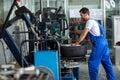 Repairman balancing car wheel on balancer Royalty Free Stock Photo