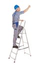 Repairman climbing step ladder Royalty Free Stock Photo