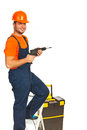 Repairman with drill Stock Images