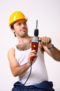 Repairman with drill on white Stock Photo