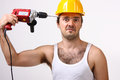 Repairman with drill on white Royalty Free Stock Photo