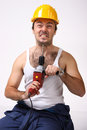 Repairman with drill on white Royalty Free Stock Photos