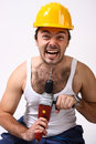 Repairman with drill on white Stock Images
