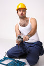 Repairman with drill on white Stock Photos