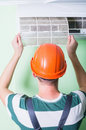 Repairman install air conditioning Royalty Free Stock Photo