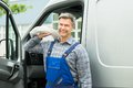 Repairman With White Cable Royalty Free Stock Photo