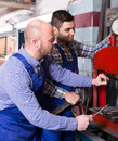 Repairmen in a workshop Royalty Free Stock Photo