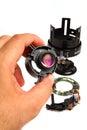 Repairwork on lens zoom element hand of repairman doing repair job a Royalty Free Stock Photos