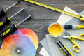 Reparing home concept. Paint and tools on wooden desk background top view