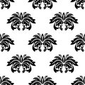Repeat seamless pattern of foliate arabesques with a leaf motif arranged in rows black and white silhouette suitable for textile Royalty Free Stock Photography