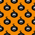 Repeatable pattern with black pumpkin over orange background seamless Stock Photo