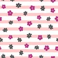 Repeated small abstract flowers on uneven striped background. Cute floral seamless pattern. Royalty Free Stock Photo