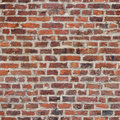 Repeating brick wall tileable rustic wallpaper background Stock Photography